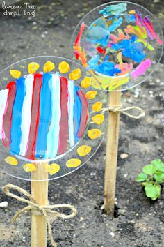Painted Garden Flowers. Made from plastic plates. Such a sweet craft project for kids.