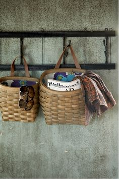 Hanging basket for his daily stuff.  Near the kitchen entry off of garage.