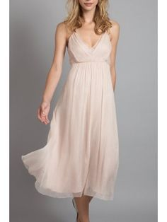 Tea length light pink dress, V neckline, simple ruffled skirt. Light weight chiffon dress for bridesmaids and evening parties.