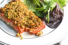 Pistachio-crusted salmon is a gourmet dinner without the gourmet skills! Prepare this with a handful of ingredients in less than 20 minutes!   aheadofthyme.com