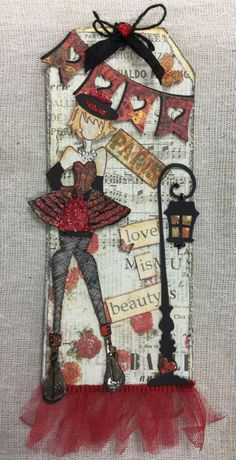 Used Julie Nutting Priscilla doll stamp, LaLa Land banner and Magnolia lanterns. Had to multi-layer her skirt for more of a 3D effect.  So much fun! Fishnet stockings were drawn in. Created by Joanne Scott