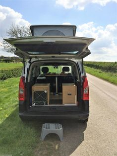 Solid wooden floor / seats / bed self-inflating bed roll / new portable toilet & storage cupboards / new 12v electric cool-box / table / portable single burner gas (cassette) cooker / 10ltr. fresh & waste water carriers / blackout curtains / outside step / Reimo pole-free tailgate awning. | eBay!