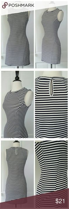 Navy And White Striped Sleeveless Dress Sleeveless dress with princess seams and back keyhole button closure. Narrow dark navy and white stripes. Monteau Dresses