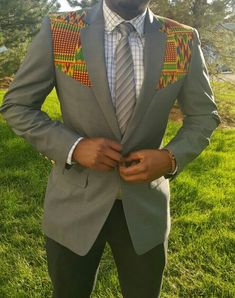 Classic blazer for the dapper gent. Pop the collar and it transforms into another blazer style, so you're getting 2 blazers for the price of one. US Size EU Size Letter Size 34 44 S 36 46 38 48 M 40 50 42 52 L 44 54 48 58 XL 50 60 XXL African Inspired Fashion, African Print Fashion, Africa Fashion, Blazer Fashion, Suit Fashion, Grey Fashion, Fashion Clothes, Mens Fashion, African Attire