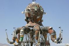 Steampunk Octopus at Burning Man  This tour de force, fire breathing marvel was built out of old trash cans and other recycled materials by Duane Flatmo, Steve Gellman and Jerry Kunkel. The tentacles, eyes and mouth parts all moved and fire shot out of the tentacles and the head.