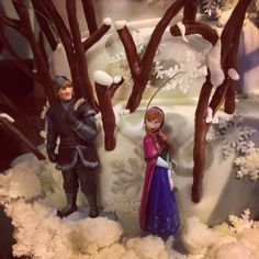 Kristoff and princess Anna Disney frozen characters and toy cake topper by chenjezzycoolcakes