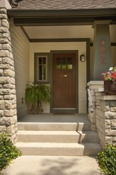 A great example of a Craftsman style front entrance.  But the perfectionist in me would paint a thin black line in the trim piece between the window and the door so it looked like two pieces!  LOL