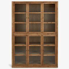 Recycled pine is reinvented in this industrially inspired design, featuring a weathered finish and metal accents that contrast the rustic aesthetic of natural wood. Ample shelving allows for beautiful and creative displays, showcased behind simple glass door. The versatile design can be used as a bookcase, or a curio cabinet.