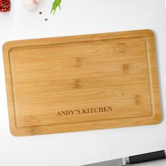 Any aspiring chef will love this Personalised Rectangle Bamboo Chopping Board – Name. Unlike a bottle of wine or flowers, this practical gift is going to last! As the description says, you can have it customised to clearly carry the name of the recipient so that it's really special.If your chef is environmentally aware, then this has two more pluses. The chopping board is made of bamboo, which is a sustainable, fast growing wood and, of course, when the time eventually comes to retire it, Wooden Chopping Boards, Bamboo Cutting Board, Personalised Gift Shop, Practical Gifts, Kind Words, Rectangle Shape, Wood Colors, Keep It Cleaner, Biodegradable Products