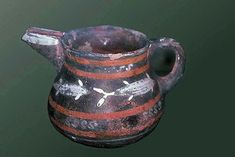 Prepalatial-style pottery with characteristic light on dark decorations