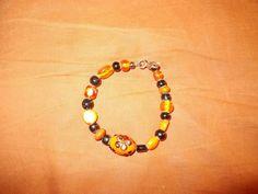 Orange and Black bracelet by kincaidariel on Etsy, $9.00