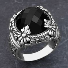 Add to your beauty with this artfully handmade floral cawi ring. Crafted of sterling silver and black onyx, this piece is a perfect addition to your jewelry collection.