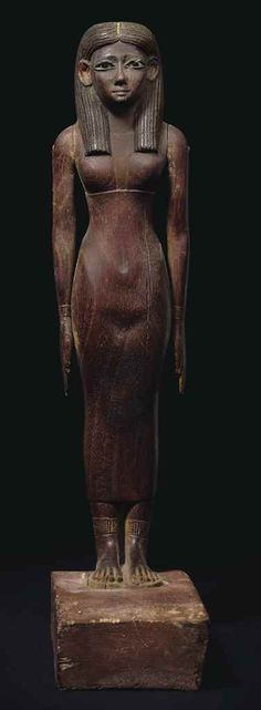 Wooden sculpture of lady. Middle Kingdom. Early 12th dynasty, c. 1981-1802 B.C. | Christie's