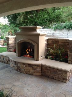 Nice Stamped Concrete design & color....and Fireplace by American Fyre Designs