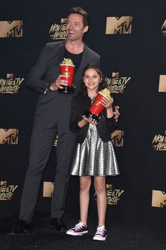 Hugh Jackman Photos Photos - Actors Hugh Jackman (L) and Dafne Keen, winners of Best Duo for 'Logan', pose in the press room during the 2017 MTV Movie And TV Awards at The Shrine Auditorium on May 7, 2017 in Los Angeles, California. - 2017 MTV Movie and TV Awards - Press Room