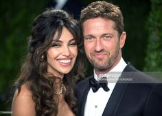 Actor Gerard Butler (R) and actress/model Madalina Ghenea arrive at the 2013 Vanity Fair Oscar Party on February 24, 2013 in Hollywood, California. AFP PHOTO / ADRIAN SANCHEZ-GONZALEZ