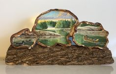 This oil painting is inspired by some of my ancestry: French-Canadian voyageurs. The scene is painted across a trio of artist's conks (bracket fungus) and securely attached to a hardened and preserved piece of tree bark. Mushroom Paint, Mushroom Crafts, Tree Trunk Slices, Painted Rocks, Hand Painted, Natural Curiosities, Tree Bark, Fungi, Rock Painting