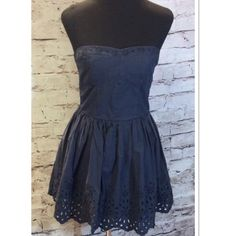 SZ LG HOLLISTER STRAPLESS DRESS IN NAVY Precious dress with eyelet cutout detail on the top and bottom. Boning in the sides around the bust and an elastic smocked back. Pull on entry and lined. Hollister Dresses Strapless