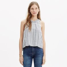 A sleeveless cropped top with swingy pleats, this tank toes the line between sexy and sweet. Particularly appealing in a mix of stripes. <ul><li>True to size.</li><li>Cotton.</li><li>Machine wash.</li><li>Import.</li></ul>
