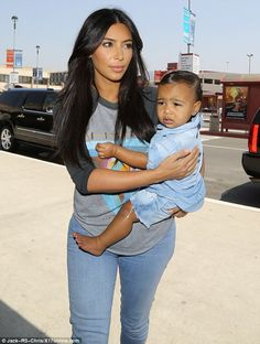 ... of LA with a very precious cargo on her hip- her daughter <b>North West</b>