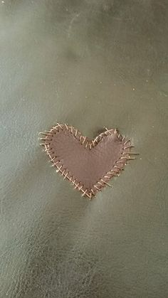 We had a hole in our sofa so I patched it up with a leather heart patch! #Ember