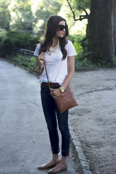 White T Shirt tucked in to black Jeans with Leather Bag and Jewelry - Necklace