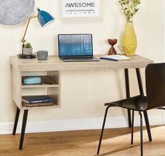 This mid-century modern themed desk offers ample desk space and storage. The mid-century styled desk includes two open storage shelves and black finish metal tapered legs. Furniture Deals, Home Office Furniture, Furniture Outlet, Online Furniture, Mid Century Legs, Contemporary Desk, Laminated Mdf, Best Desk, Small Space Living