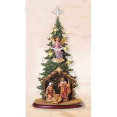 """Amazon.com: Fontanini 5"""" Lighted Christmas Tree with Nativity Stable Base #54647: Home & Kitchen"""