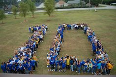 "this would be so cool!. I really want to do something like this; we could get all of the seniors taken in this photo on the field, but making ""14' with the triangle 4.(: -miriam"
