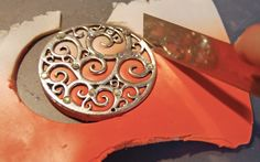 Add Polymer clay to a plain metal focal piece or pendant to make it really special!