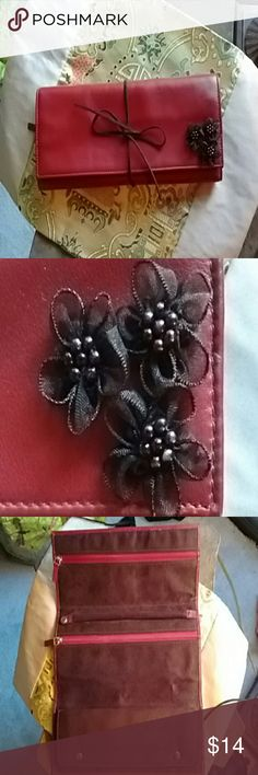 Deep red clutch Dark red with maroon flower trim and suede tie. It may actually be a jewelry travel case. Expert opinions  welcomed! none I can see Bags Clutches & Wristlets
