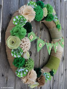 The red and pink of Valentine's Day is ready to be packed away and it is time to take out a little bit of green and jazz things up. If you are ready forsomething new, here is a lucky wreath that is fun and easy to make and perfect for the front door, a St. Paddy's mantel or part of the wall decor. Alison shows us howto mix and match greens in paper and fabricand turn them into St. Patrick's...
