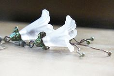 Steampunk Bridal Earrings. Large Snow White Frosted Trumpet Flower. Antique Bronze Metal Beads. GREEN Detail. Nature Inspired. tagt