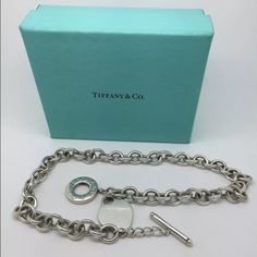 """Tiffany & Co. Sterling Silver Necklace 16"""" Tiffany Silver Toggle Necklace.  I listed as pre-owned, Measures 16"""" in length with toggle clasp.  Marked Tiffany & Co..  0.925 sterling silver. This necklace makes a real fashion statement.  It's appropriate for work, fun, or as your signature piece.  Necklaces of this nature are no longer produced or for sale by Tiffany.  It is an authentic Tiffany product. If you have any questions, please let me know. I'd be delighted to help you out. Pouch/box…"""