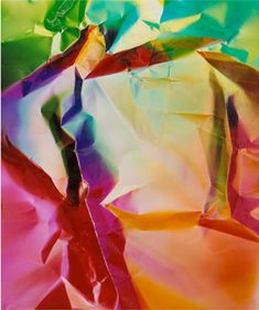 Dings and Shadows by Ellen Carrey. Her medium is plentiful, yet ephemeral - the ever changing light. Using photograms and Polaroids to create rich, colourful abstract images, she presents a body of work that is at once minimalist and many-faceted.