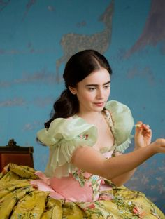 Lily Collins as Snow White in Mirror Mirror (2012).