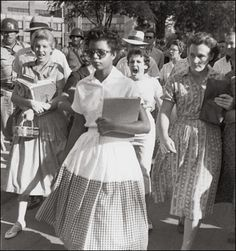 This picture is courage, revolution, hatred and disgust rolled into one.     These students detested her and wanted to deny her a basic right that every human should have - right to equality. Her name is Elizabeth Eckford.   She just knew that if she did not walk these few steps to her school, the oppressors would win. So she walked. That is courage.  By walking those few steps, she opened the door for the oppressed, ushering a new era of equality. That is revolution. Quora