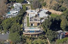 "Rihanna's new 7 million dollar bachelorette pad in Hollywood Hills even has a nickname ""The Fortress"" because of its medieval feel. It has 8 bedrooms, 12 bathrooms, and her next door neighbor? Lady Gaga. The entrance to the home is over 60 feet tall and has state of the art security systems installed because of the singer's recent run-ins with a stalker. She waited for over a year to move in because she wanted to be sure it was safe before she did."