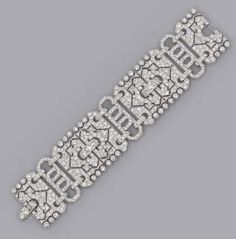 AN ART DECO DIAMOND BRACELET Designed as three pavé-set diamond openwork plaques to the geometric diamond openwork links, circa 1930, 18.5 cm long, with French asaay mark for platinum