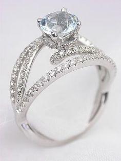 aquamarine ring.   ••••(KO) Pretty, pretty! That pale blue  Aquamarine looks like ice! Stunning on the hand.