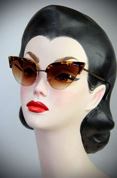 50's style Thunderbird Tortoiseshell Cat Eye Sunglasses at Deadly is the Female. The perfect way to add some kitsch atomic style to your pinup look.