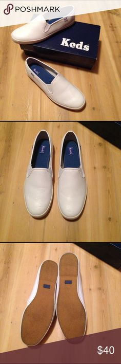 Slip on Leather Keds Excellent condition. Minor wear marks ok the bottom, but great condition. Easy to clean, wipe away surface. Comes in original box. Size 7.5 M Keds Shoes