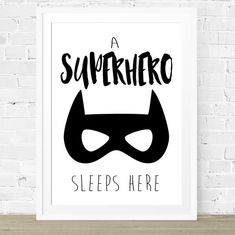 A Superhero Sleeps Here Print. Superhero Nursery Prints. The Kids Print Store. Boys Batman Bedroom Decor. Nursery and Bedroom Wall Art Prints.