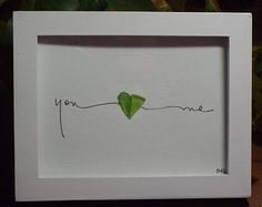 You (heart) Me - an original design combining 2 green sea glass halves to make a whole heart with hand lettering