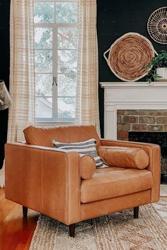 With clean lines, a tufted seat and luxuriously stuffed back cushions, this piece is worth settling into. Photo by Charlotte's Happy Home. #LoungeChair #ReadingChair #LivingRoomChair