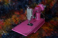 This is the thing that I sew with! This links to a site that restores Singer Featherweight sewing machines and does those fabulous painted restorations!