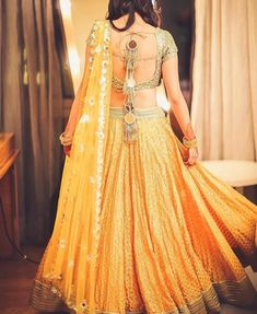 This gold & yellow mirror-work lehenga looks stunning Mehndi Outfit, Lehenga Wedding, Indian Bridal Lehenga, Lehenga Designs, Mehndi Designs, Indian Dresses, Indian Outfits, Mirror Work Lehenga, Yellow Lehenga