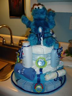 Diaper cakes made with real disposable diapers included are many different baby items.  Price depends on items &  how big.. Most are $50 but have some that start @ $40 and go as high as $60..