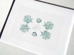 This fine art print is of 4 ocean blue branches of coral surrounding a pearl white spiral sea shell and 2 speckled blue clam shells. This is an imagined sea shell & coral collection gathered from a day at the beach. See the companion designs here: