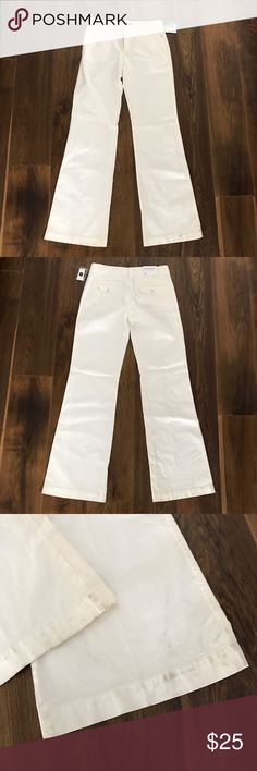 NWT GAP White Pants Size 2 Long Brand new with tags. There is some dirt on the edges from storage/falling on the ground etc and a slight makeup mark on the waistband that should come out in the wash. It is not visible when wearing or much at all, see pics. Smoke free pet friendly home. No rips or stains other than mentioned above. GAP Pants